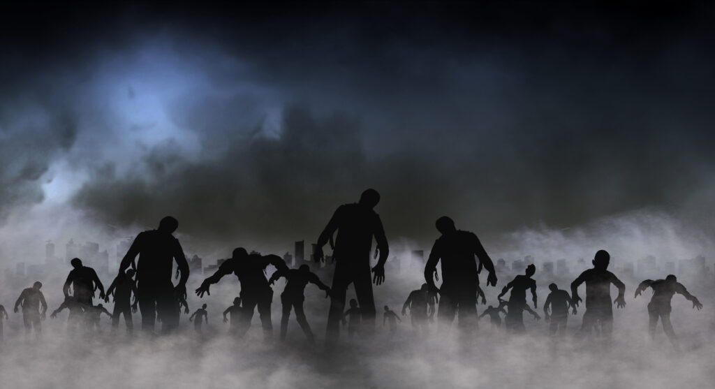 Crowd of scary zombies lurching slowly out of a fog